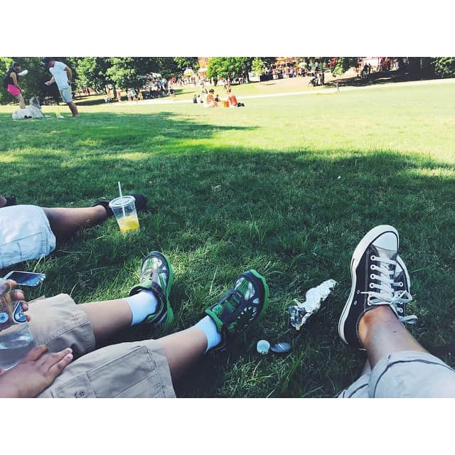 Piedmont park: sitting in the shade, full on festival food.…