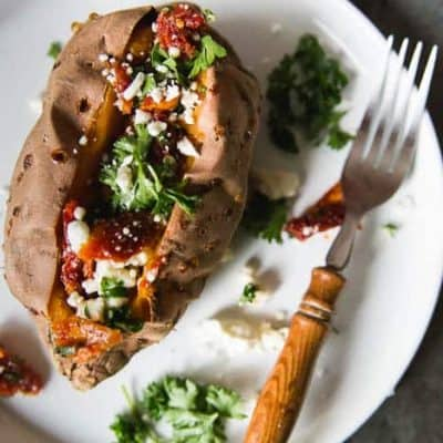 Grown up Baked Sweet Potatoes: Baked and Stuffed with Feta and Sundried Tomatoes.
