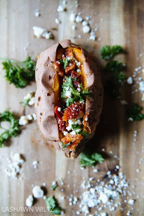Baked sweet potatoes stuffed with feta and sundried tomatoes..it's not your mama's sweet potato...