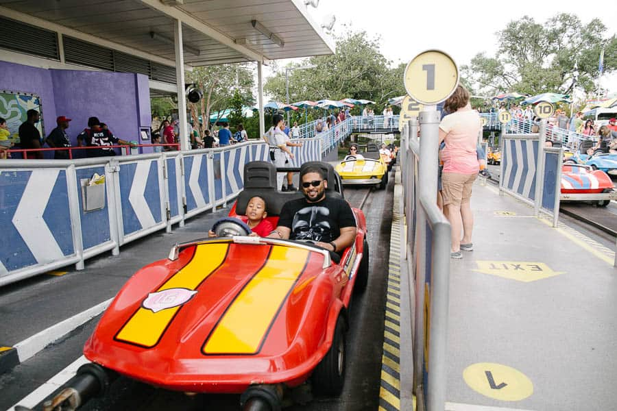 riding in the cars at disneyworld's tomorrowland speedway.