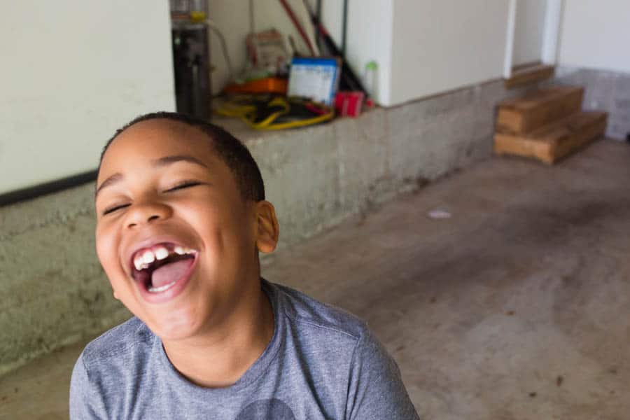 a boy laughing