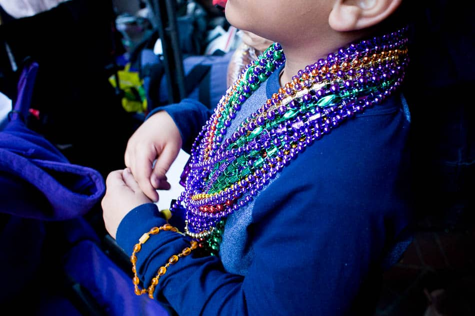 Kids love to collect beads from Mardi Gras