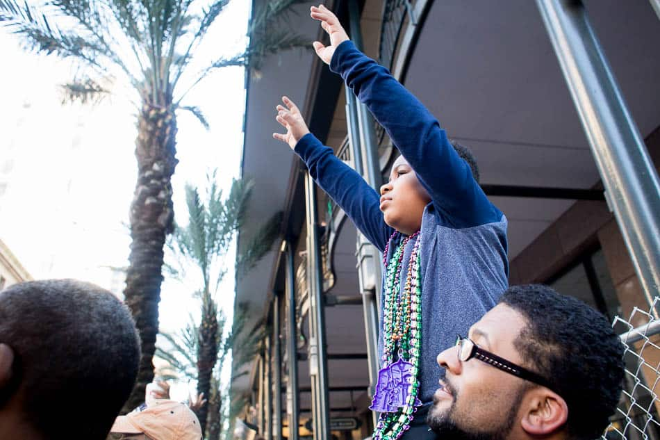 Hands up to catch beads at Mardi Gras