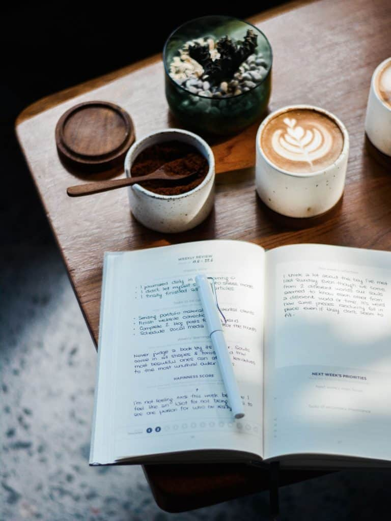 Journaling on a table with a latte