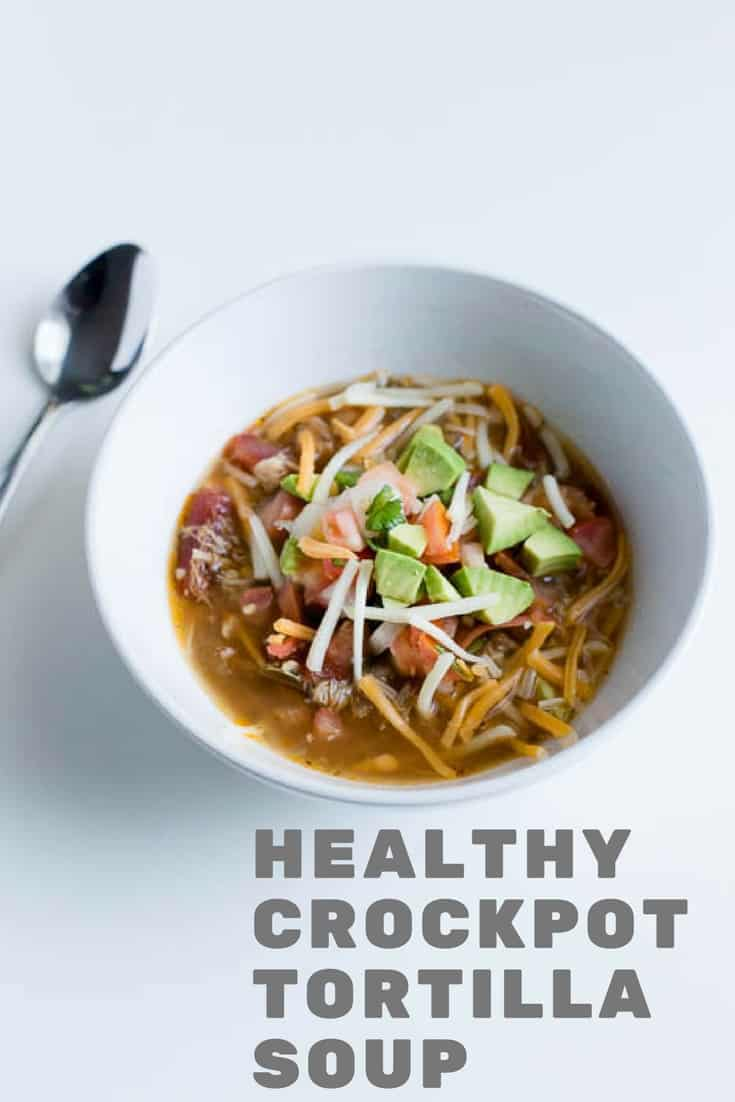 Make this easy crockpot chicken tortilla soup. Gluten free, paleo, whole 30 compliant. Easy to make in the crockpot, slow cooker or insta pot.