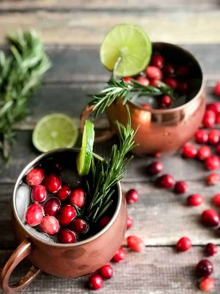 Holiday Moscow Mule with a twist! Cranberry Moscow Mule with Moscato ( a twist)! You will love this holiday twist on this classic and so will your guests this holiday season! #holidays #recipes #moscowmule