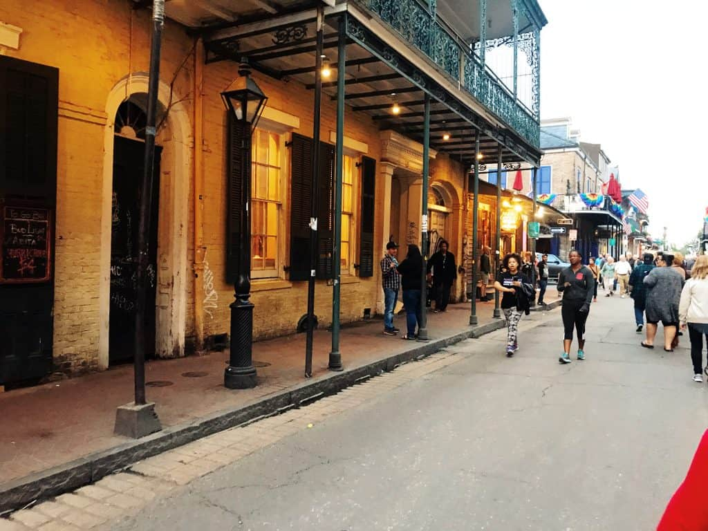 strolling down bourbon street in the french quarter