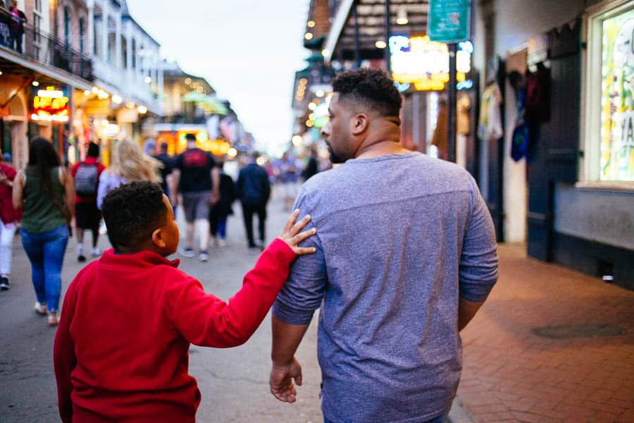my two guys in the french quarter walking down bourbon street