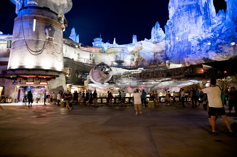 millennium falcon at night at galaxy's edge at disney world
