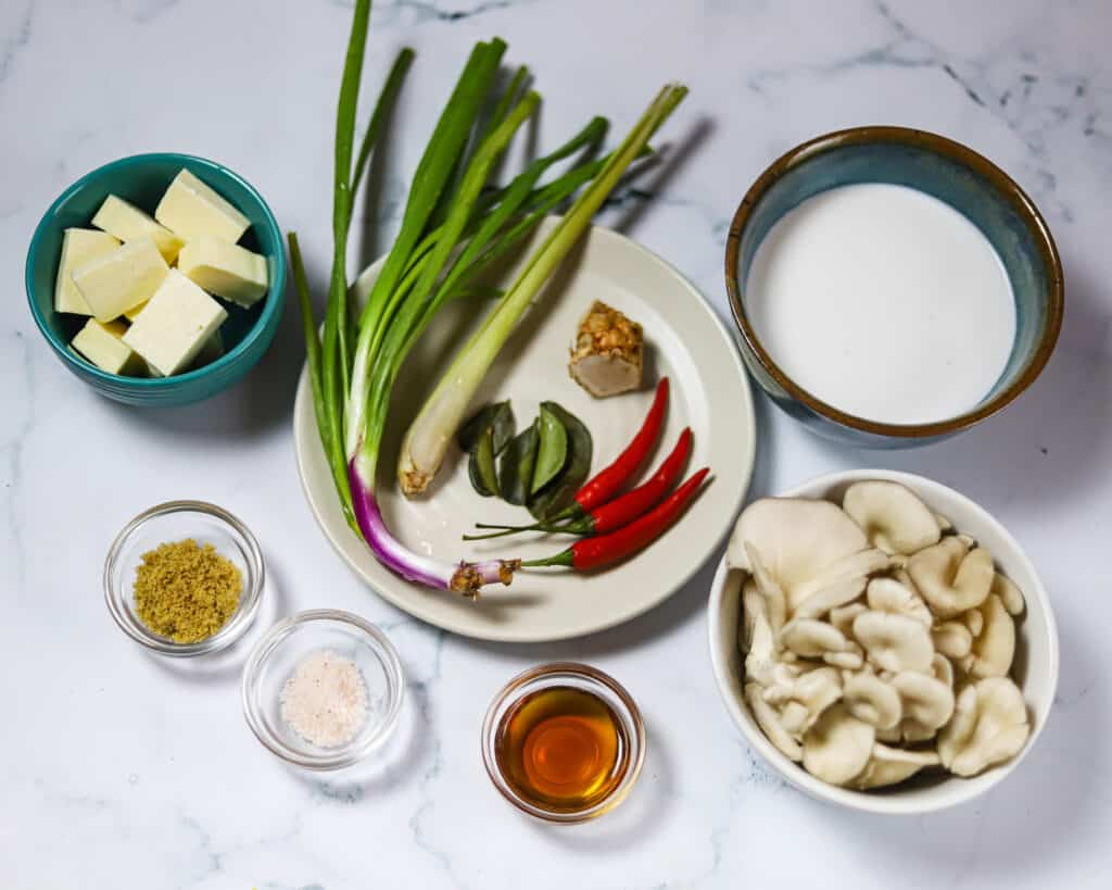 ingredients laid out for a vegan thai coconut soup