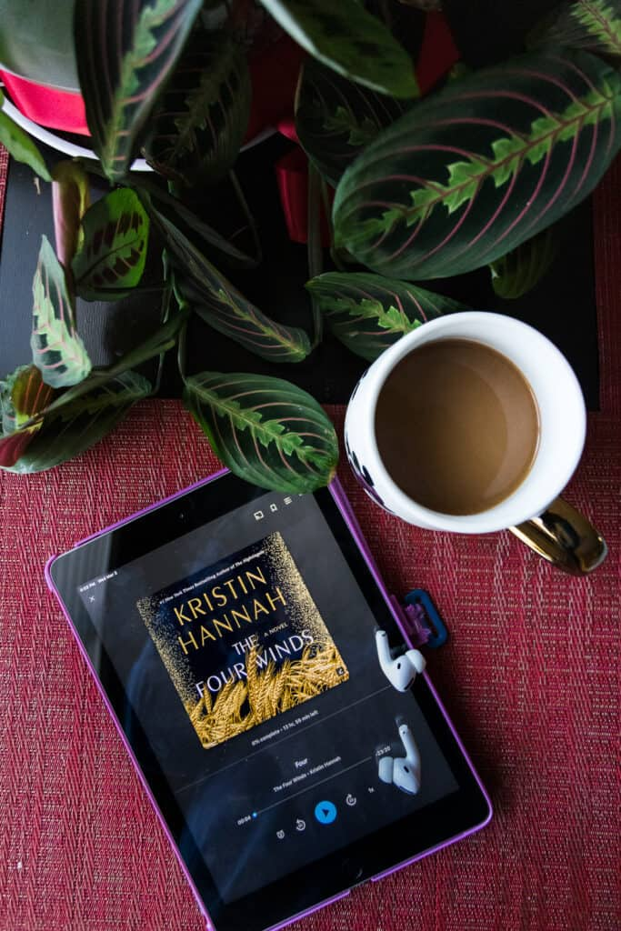 audiobooks for road trips on a table with coffee