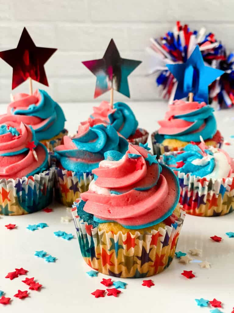 Easy to make red white and blue cupcakes for 4th of July displayed on a table.